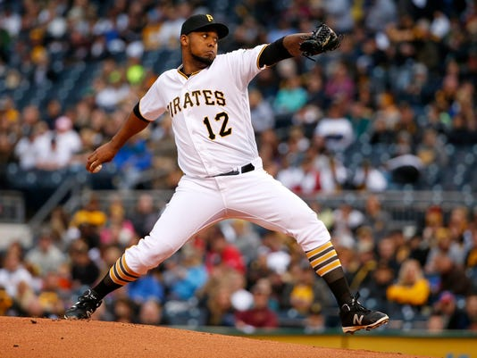 Pittsburgh Pirates starting pitcher Juan Nicasio delivers during the first inning of a baseball game against the Cincinnati Reds in Pittsburgh, Friday, April 29, 2016. (AP Photo/Gene J. Puskar)