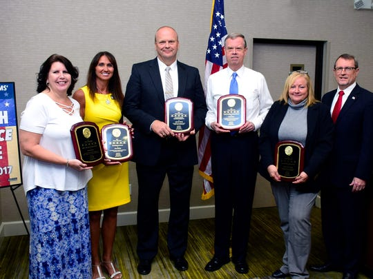 Pictured left to right are  Rhonda Shoup, Women's Center; Dana Blickley, Brevard Property Appraiser; BCSO Agent Joe Martin; Assistant State Attorney Michael Hunt; Indian Harbor Beach Detective Corp. Lisa German; and, State Attorney Phil Archer.