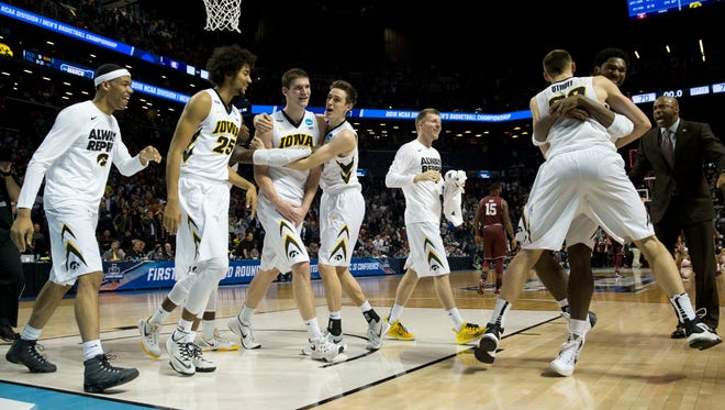 ADDS ID OF SCORER OF WINNING BASKET - Iowa's Adam Woodberry, third from left, celebrates with teammates after scoring the game-winning basket in their 72-70 win over against Temple in overtime of a first round men's college basketball game in the NCAA Tournament, Friday, March 18, 2016, in New York. (AP Photo/Mary Altaffer)
