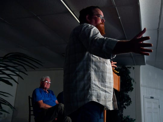 Jon Awbrey, the editor and publisher of the De Leon Free Press and a De Leon City Council member, addresses the audience during Thursday's meeting of the Comanche County Taxpayer's Co-op.. Behind him sits Keith Moon, the founder of the group.