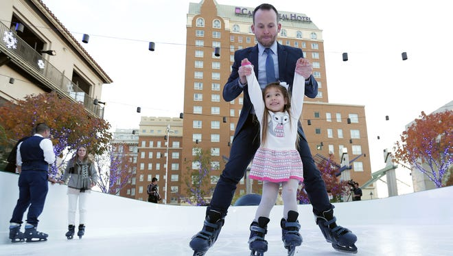 Destination El Paso General Manager Bryan Crowe helps 5-year-old Gabi Short learn to skate Thursday on the ice rink at Arts Festival Plaza. The Winterfest rink will open Saturday just before the Christmas tree lighting at San Jacinto Plaza. Winterfest runs from Saturday to Jan. 8.