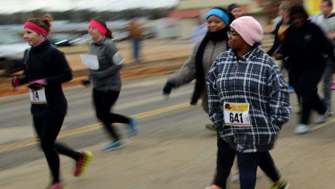 Over 800 runners gathered early Thursday morning to run the Gold's Gym10th annual Turkey Day 5K starting on on Carriage House Drive. Proceeds from the race benefit RIFA and more than $11,000 was donated last year.
