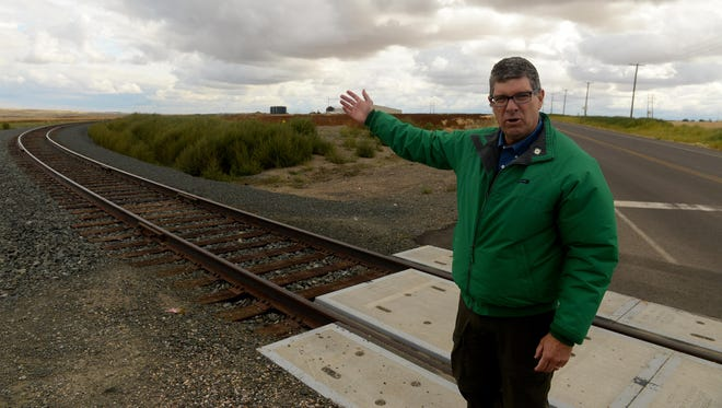 Great Falls Development Authority President Brett Doney stands at the rail spur serving the Great Falls AgriTech Park, which opened last month. Five industrial lots have been sold and are being developed at the park.