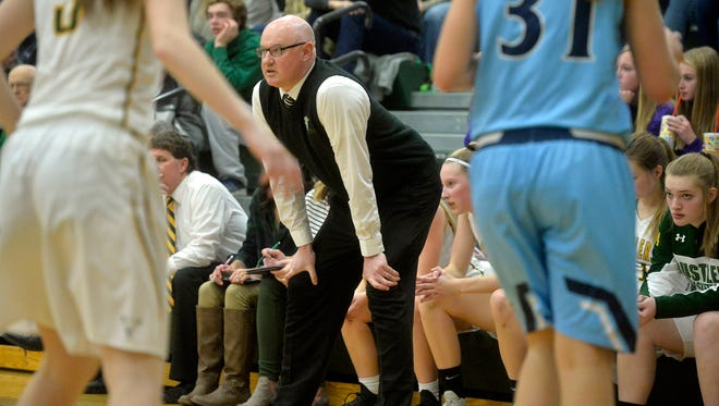 CMR basketball coach Brian Crosby looks on from the sideline during last week's crosstown basketball game in the CMR Fieldhouse.