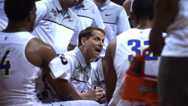 Nevada head coach Eric Musselman conducts a timeout while taking on UNLV during the Mountain West Tournament.