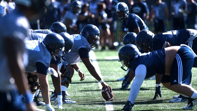The Nevada Wolf Pack football team lines up for a play during its first fall camp practice.
