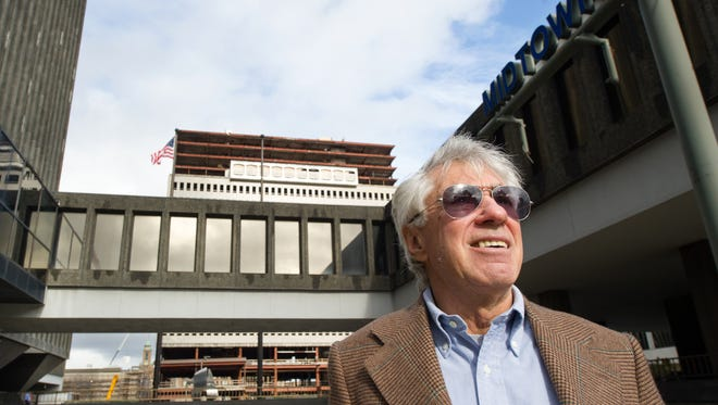 A file photo of NYC developer David Walentas taking a tour of Midtown in downtown Rochester.