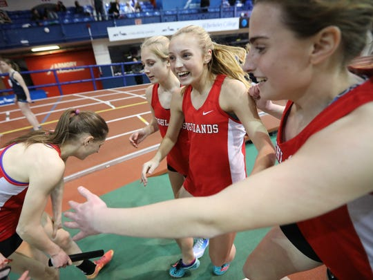 Kyla Krawczyk (center standing) and the rest of the Highlands winning 4x400 meter relay team celebrates at the Bergen County Indoor Track Relays at The Armory in New York City. Wednesday, January 25, 2017.