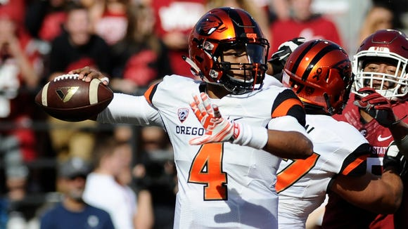 Oct 17, 2015; Pullman, WA, USA; Oregon State Beavers quarterback Seth Collins (4) drops back for a pass against the Washington State Cougars during the first half at Martin Stadium. Mandatory Credit: James Snook-USA TODAY Sports