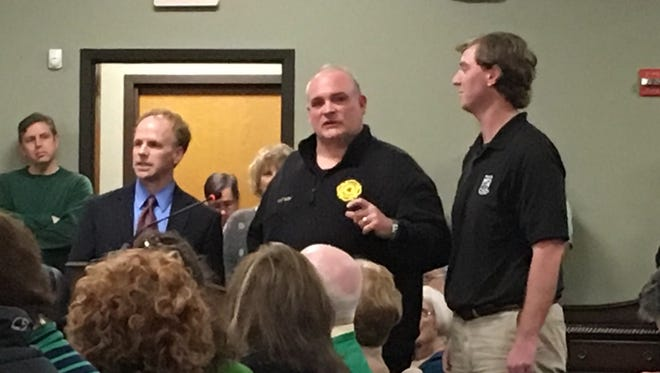 Hendersonville Fire Chief (center) along with Mayor Jamie Clary recognize Chris Stubbs (right) at the Feb. 27 BOMA meeting.