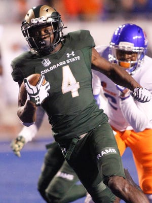 CSU wide receiver Michael Gallup (4) runs the ball during the second half Boise State on Saturday. Gallup's 53-yard touchdown catch sparked a wild comeback attempt by the Rams.