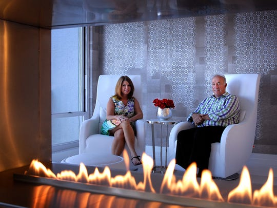 Framed by the warming flames of their fireplace, Mary and Don Kosch get a perfect view from their bedroom into the living area.