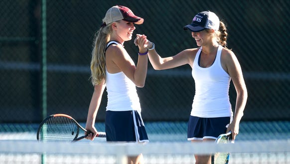Asheville School's Sarah Abernethy, left, and Rachel