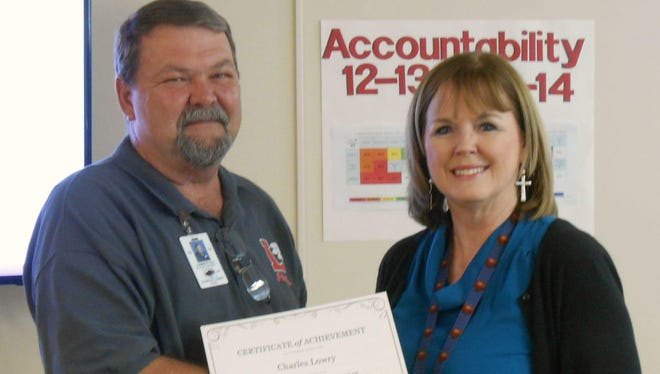 Charles Lowry was named Lumberton School District's Employee of the Year. He is pictured with Superintendent Linda Smith.