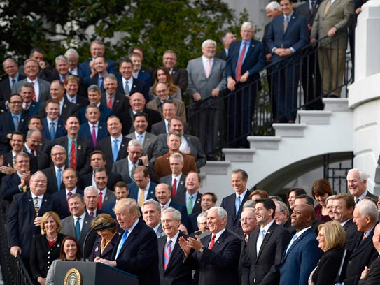 Lawmakers listen to US President Donald Trump speak