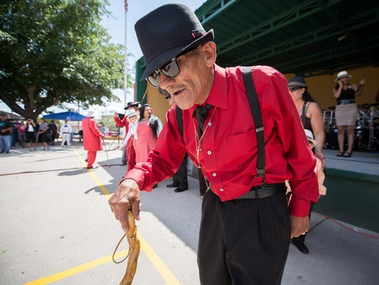 Zoot suit contest participant Danny Ruiz poses for