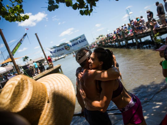 "Cheyenne Rotunno hugs her father, Peter Jenks, after winning gate ""Practically Professionals"" canoe race during the 41st annual Great Dock Canoe Race at the Naples City Dock at Crayton Cove."
