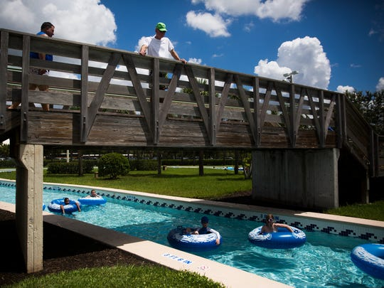 Kids float down the lazy river at Sun-N-Fun Lagoon in North Naples on Wednesday, June 28, 2017.