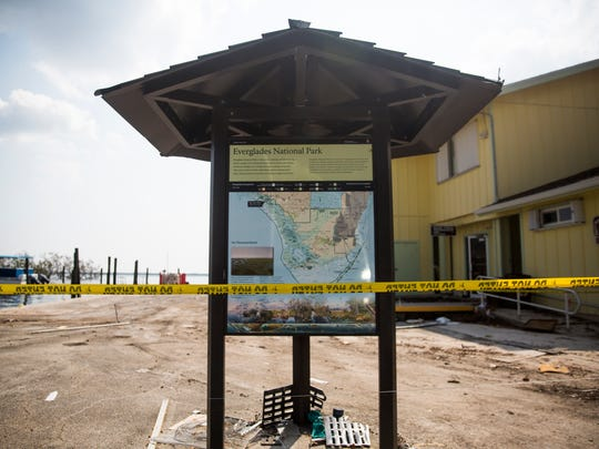 Caution tape blocks pedestrians from entering the Gulf Coast Visitor Center on Thursday, Sept. 21, 2017, at an entrance to Everglades National Park in Everglades City.