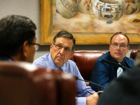 San Juan County Commissioners Keith Johns, center, and Scott  Eckstein listen as Navajo Nation President Russell Begaye, left, speaks Tuesday during a San Juan County Commission meeting in Aztec.