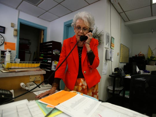 Judy Nelson answers phones Friday at Judy Nelson Elementary