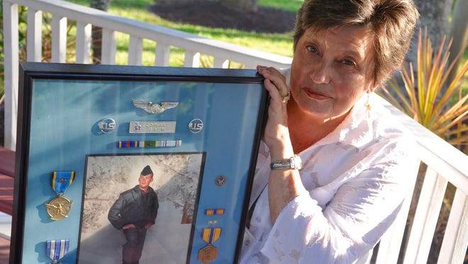 Estero Councilwoman Katy Errington holds a photo of her son, Sgt. Philip Kesler, who was killed during a training exercise in 1992. She will speak at the Elks Lodge on Veterans Day.