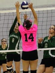 Cloudcroft's Kaitlynn Bowman (8) tries to set a ball