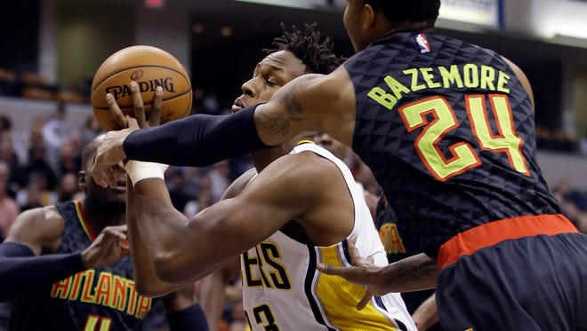 Indiana Pacers' Myles Turner (33) shoots against Atlanta Hawks' Kent Bazemore (24) during the first half of an NBA basketball game Thursday, Jan. 28, 2016, in Indianapolis. (AP Photo/Darron Cummings)