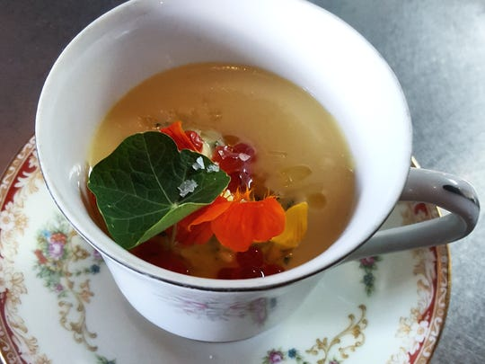 Chilled squash soup with Asian carp, eggs and nasturtium