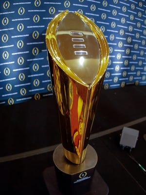 The College Football Playoff national championship trophy on display.