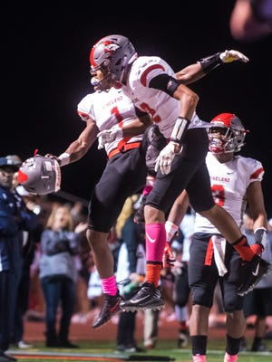 Vineland celebrates a touchdown by wide receiver Tyreem Powell (22) against Atlantic City at Atlantic City on Friday, October 20.