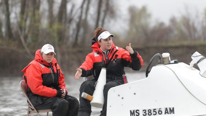 Andrea Landry, right, delivers instructions at the helm as coach of the UMass rowing program. The former Shewsbury High star rower will now lead the Holy Cross women's rowing team.