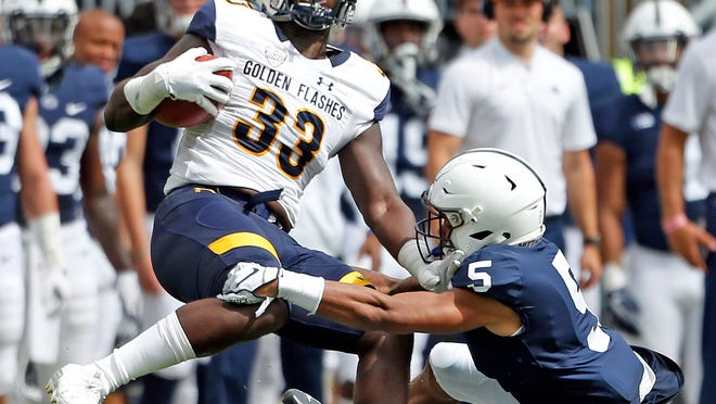 Kent State running back Jo-El Shaw is tackled by Penn State's Tariq Castro-Fields when the two teams last met in September of 2018 in State College, Pa. The Golden Flashes and Nittany Lions were scheduled to meet once again in the 2020 season opener, but the game was cancelled on Thursday when the Big Ten announced that it will play only conference games this fall.