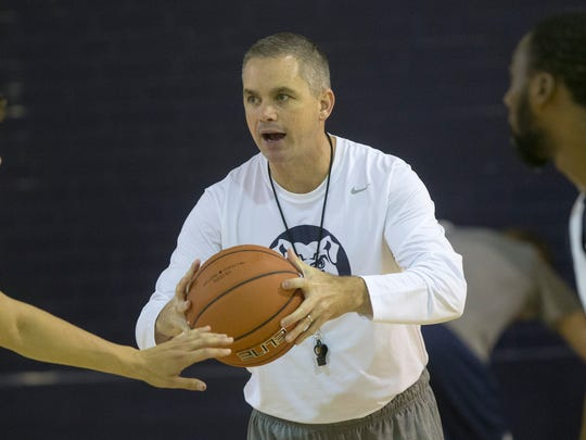 Chris Holtmann, interim Head Coach of the Butler Men's Basketball team, works his team through practice, Indianapolis, Sunday, October 12, 2014.