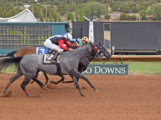 Popalicious wins with a neck victory over Sky Rant in the $50,000 First Lady Handicap Monday.