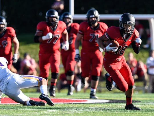 St. Cloud State's John Pass carries the ball during