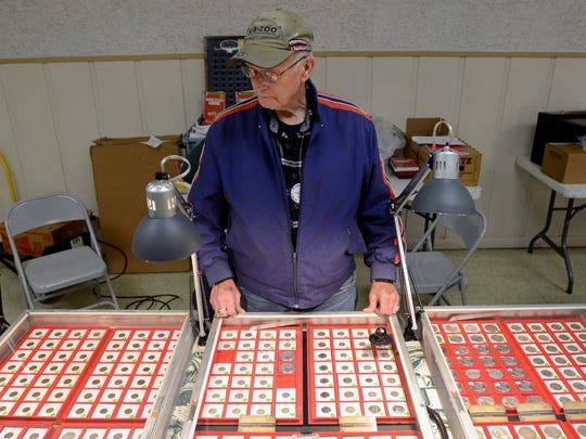Al VanBuskirk, a Marysville coin collector and dealer, looks over his coins Sunday, May 22, during the Marysville Coin Club's spring show at the American Legion in Marysville.