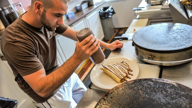 """Matt Zadroga puts the finishing touches on a """"classic"""" crepe at Whipped Creperie in Red Bank."""