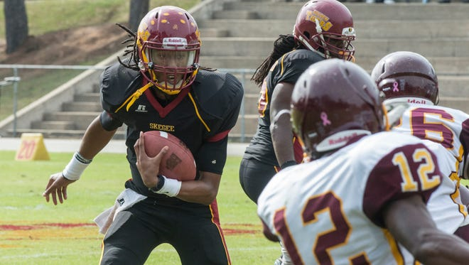 Tuskegee quarterback Kevin Lacey looks for room to run. The Tuskegee Golden Tigers faced the Central State Marauders on Saturday, Oct. 31, 2015, in Tuskegee.