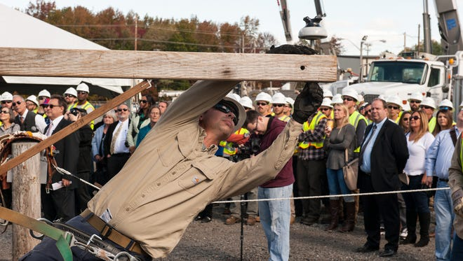 A JCP&L employee demonstrates pole work at the utility's training facility in Howell.