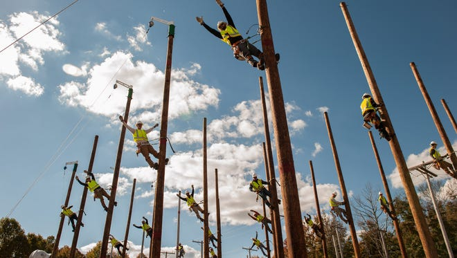 Students at JCP&L's training facility in Howell demonstrate their pole-climbing skills.