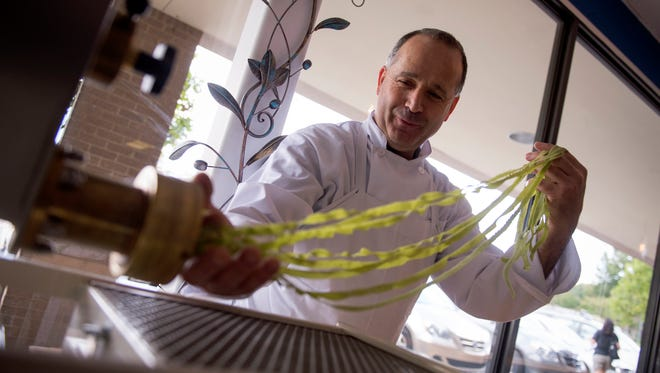 Chef Michele D'Oto making fresh spinach tagliatelle at his restaurant The Pasta Maker, which announced its closure Wednesday.