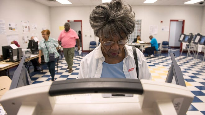 November 2, 2016 - Artie Henry (center) and others take advantage of early voting to cast their ballots at Glenview Community Center in Memphis, one of 20 early voting locations in Shelby County. Early voting continues through November 3. (Brandon Dill/Special to The Commercial Appeal)