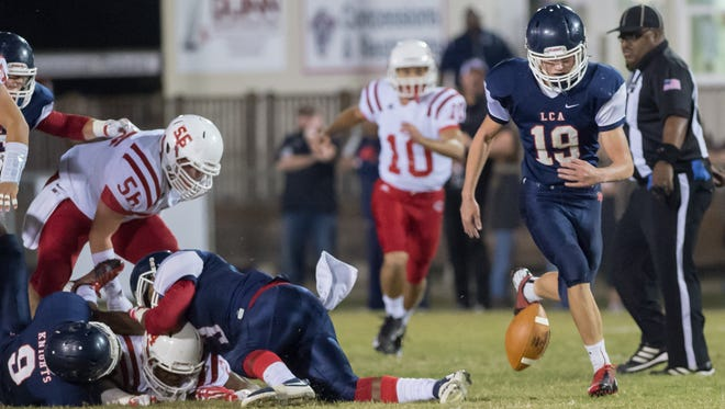 Nicholas Picard makes a fumble recovery as Lafayette Christian Academy host Central Catholic in Football playoffs. November 11, 2016