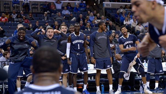 Monmouth University players react after Austin Tilghman scores and is fouled. The Hawks defeated Memphis, 82-79