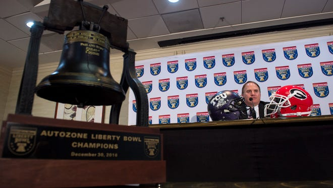 The AutoZone Liberty Bowl Trophy sits on a table beside Gary Patterson, head coach of the Texas Christian University football team, as he speaks during a press conference at an Embassy Suites hotel in Memphis on Thursday, Dec. 29, 2016. TCU will play the University of Georgia in the 58th AutoZone Liberty Bowl on Friday.