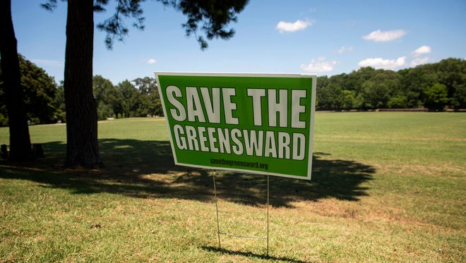 """July 1, 2016 - A """"Save the Greensward"""" sign is posted near the WWI memorial at Overton Park. Memphis mayor Jim Strickland announced today a plan to resolve the ongoing dispute over usage of the grassy area at Overton Park, commonly known as the Greensward, as overflow parking for the Memphis Zoo. (Brandon Dill/Special to The Commercial Appeal)"""