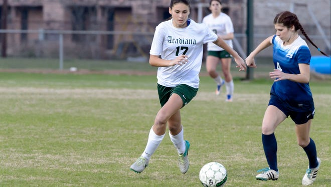 Hailey Daigle moves the ball down field as Acadiana takes on Barbe. Wednesday, Feb. 8, 2017.