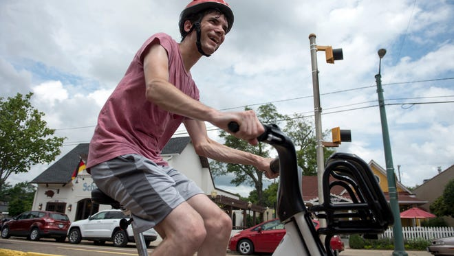July 27, 2016 - Andrew O'Sullivan tries out a bicycle from Explore Bike Share after the group set up a demonstration bike share station at Overton Square. The project aims to install 600 bicycles from BCycle at 60 stations throughout the city. Expolore would offer users short term rentals of the bicycles for everything from commuters needing to travel the last mile to and from a bus stop, residents running errands, or for tourists exploring the city. The group is halfway through their four million-dollar fundraising goal and hopes to install the sharing stations in 2017.  (Brandon Dill/Special to The Commercial Appeal)