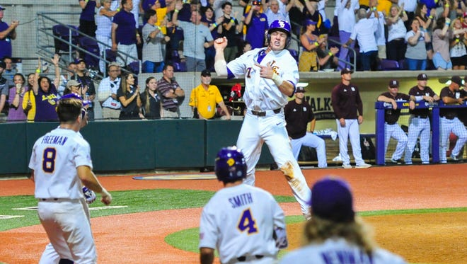 Josh Smith celebrates after scoring a run as Mississippi State takes on LSU in the NCAA Super Regional at Alex Box Stadium in Baton Rouge, LA.- Saturday, June 10, 2017.